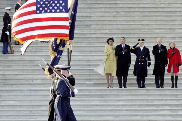 The Armed Forces Joint Color Guard passes in review at the east front of the U.S. Capitol during the 56th Presidential Inauguration in Washington, D.C., prior to beginning the inaugural parade Jan. 20. Armed Forces Inaugural Committee Commander Maj. Gen. Richard J. Rowe Jr. stands with President Barack Obama, Michelle Obama, Vice President Joe Biden and his wife Dr. Jill Tracy Biden.
