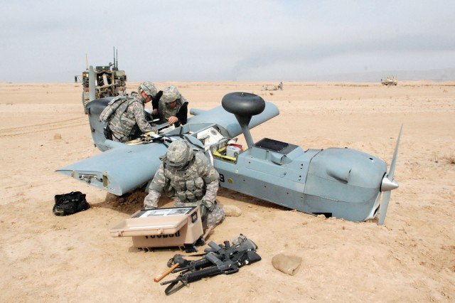 Members of the 10th Combat Aviation Brigade's 277th Aviation Support Battalion downed aircraft recovery team work to remove the wings from the fuselage of a Hunter Unmanned Aerial Vehicle that made an emergency landing near Baji, north of Tikrit, Jan. 20. After the wings and tail were removed, the disassembled aircraft was loaded into a 3rd General Support Aviation Battalion CH-47 Chinook, while 1st Attack Reconnaissance Battalion AH-64 Apaches, 6th Squadron, 6th Cavalry Regiment OH-58D Kiowa Warriors, and ground forces from Fox Company, 2nd Battalion's Pathfinders secured the site.