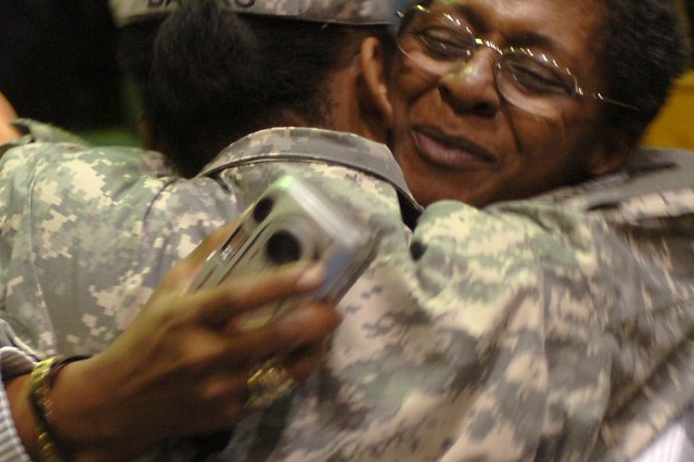 Staff Sgt. Tameka Banks, with the 297th Trans. Co., 180th Trans. Bn., 15th SB, 13th ESC, gives a hug to her mother Dorothy Banks Jan. 14 at the Kieschnick Physical Fitness Center after returning from Iraq.