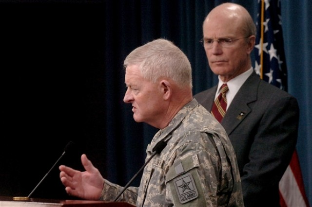 As Army Secretary Pete Geren, right, looks on, Lt. Gen. Clyde Vaughn, director of the Army National Guard, speaks at a Pentagon news conference on the mission of the Guard's agricultural development teams, Jan. 22.