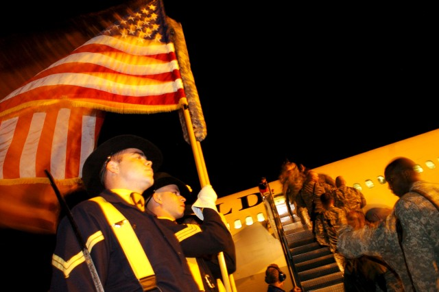 The 1st Cavalry Division Honor Guard formally sends off troops from the Division Special Troops Battalion, 1st Cav. Div., at the Gray Army Airfield flight line Jan. 17.