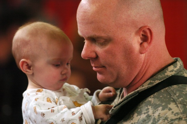 Lt. Col. James Brown, deputy Operations officer, Division Special Troops Battalion, 1st Cavalry Division, spends some quality time at Ironhorse Gym on Fort Hood, Texas, with his 9-month-old daughter Jayme Jan. 17.""