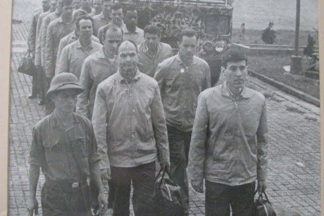 This picture of Vietnam POWs walking from a bus to a C-141 and to freedom was taken in North Vietnam. POW Leo Thorsness is the eighth man in the line to the right. The fifth man in the line to the right is the now deceased Mike Christian, who was from Huntsville and who is known for the U.S. flags he made while in captivity.