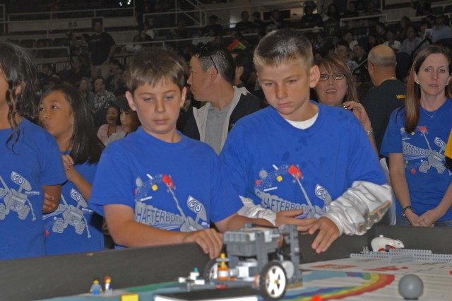 Ft. Shafter, Hawaii - Shafter Elementary's Scott Greene, 11 (left) and Kyle Bender, 10 (right) make adjustments to their robot during the Hawai'i FIRST LEGO® League State Championship Tournament which was held at the Neal S. Blaisdell Arena in Honolulu.