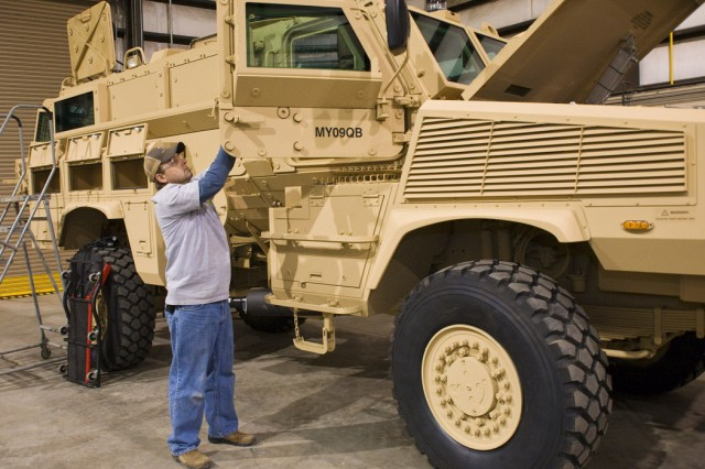 General Dynamics Land Systems technician Randy Beane inspects the door of an RG-31 Mine Resistant Ambush Protected vehicle at Anniston Army Depot. Similar to the Cougar MRAP program, the depot has partnered with GDLS to complete production on the RG-31.