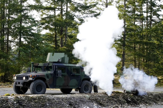 A vehicle is hit by a simulated IED Jan. 15 during training on a range at Fort Lewis.