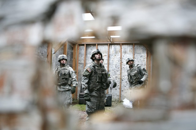 Soldiers from Co. A. 2nd Bn., 3rd Inf. search a simulated Iraqi home for sensitive items Dec. 11, 2008 during training on a range at Fort Lewis.