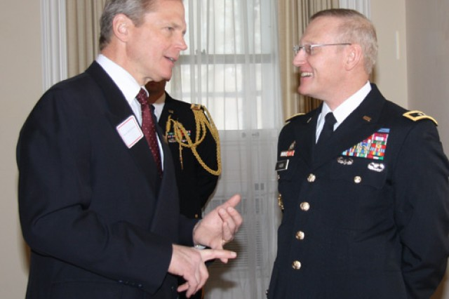 Rock Island, Ill., Mayor Mark Schwiebert talks with Maj. Gen. Robert M. Radin, commanding general of the U.S. Army Sustainment Command, during the annual New Year reception at Quarters One on Rock Island Arsenal, Ill.