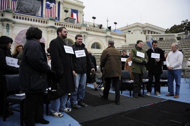 Role players file on and file off the stage as the Joint Congressional Committee on Inaugural Ceremonies leads the Presidential Inaugural Committee and Armed Forces Inaugural Committee  in a rehearsal at the U.S. Capitol for the 56th Presidential Inauguration in Washington, D.C., Jan. 18.