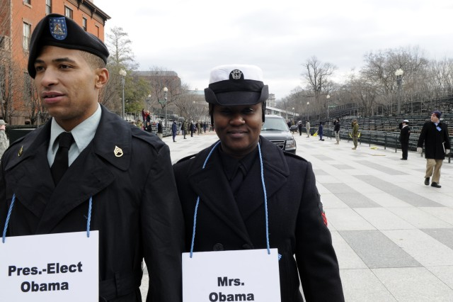 Army Staff Sgt. Derrick Brooks, left, and Navy Yeoman 1st Class Lasean McCray role-play President-elect Barack Obama and Michelle Obama during the dress rehearsal of the 56th Inauguration Parade along Pennsylvania Avenue in Washington, D.C., Jan. 11.