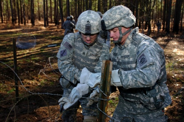 """Paratroopers of Company A, 508th Special Troops Battalion, 4th Brigade Combat Team, 82nd Airborne Division set up a wire obstacle Jan. 15 on  Fort Bragg during the unit's """"Sapper Stakes"""" competition. The competition was held to see what squad had the best combat engineer skills."""