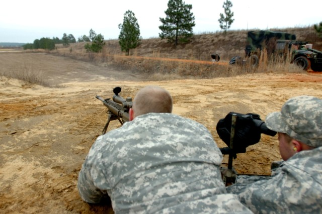 Spc. Jeff Mews, left, aims an M-110 rifle while Pfc. Phillip Adams spots the target Jan. 13 at a range on Fort Bragg, N.C. Mews and Adams are snipers in the 4th Squadron, 73rd Cavalry Regiment, 4th Brigade Combat Team, 82nd Airborne. The snipers remove their armor to maximize accuracy when set up in a firing position downrange, and train to fire that way in garrison.