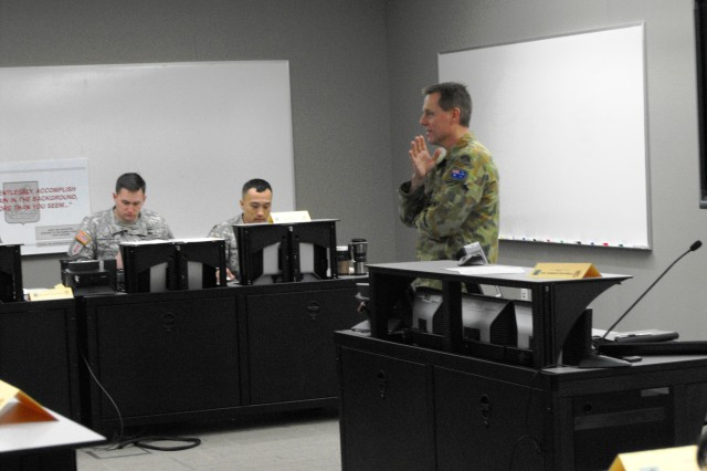 Australian Army Col. Damian Cantwell, seminar leader, addresses SAMS students in their newly upgraded classroom as part of orientation Jan. 23.