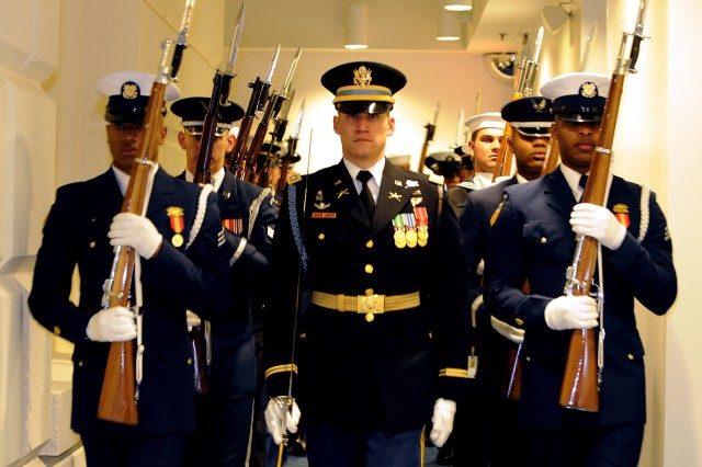 Members of the joint honor cordon carry weapons at port arms as they prepare for the start of the 56th Presidential Inauguration in Washington, D.C., Jan. 20, 2009. More than 5,000 men and women in uniform provided military ceremonial support to the presidential inauguration, a tradition dating back to George Washington's 1789 inauguration.