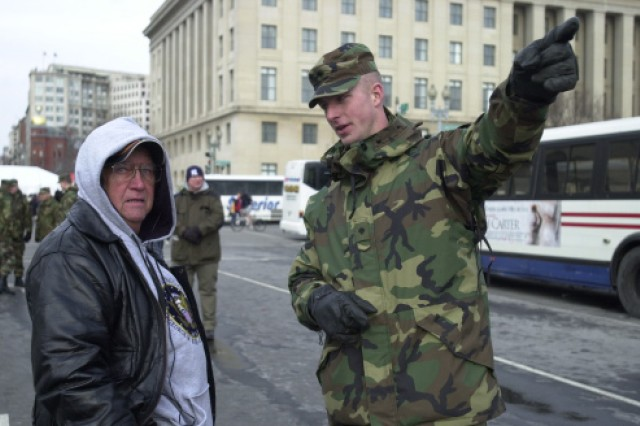 Virginia Army National Guard Spc. Jerry Andes offers directions to one of the many people who passed through a U.S. Secret Service checkpoint to watch the inaugural parade in Washington, D.C., on Jan. 20, 2009.