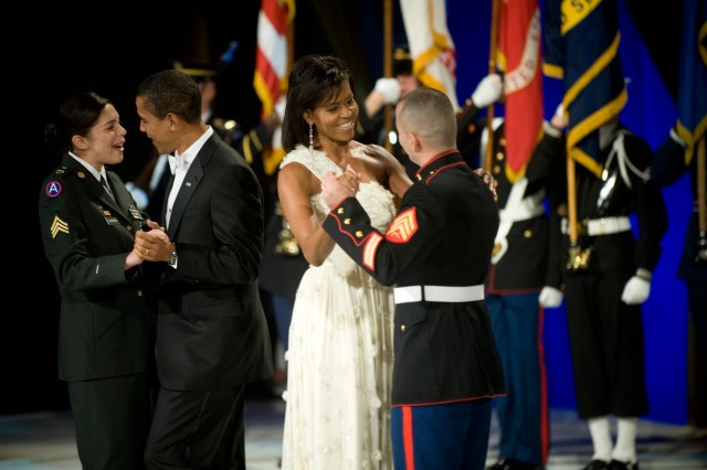 President Barack Obama dances with Sgt. Margaret H. Herrera while first lady Michelle Obama dances with Marine Corps Sgt. Elidio Guillen at the Commander-in-Chief's Ball at the National Building Museum in Washington, D.C., Jan. 20, 2009. The ball honored America's servicemembers, families, the fallen and wounded warriors.