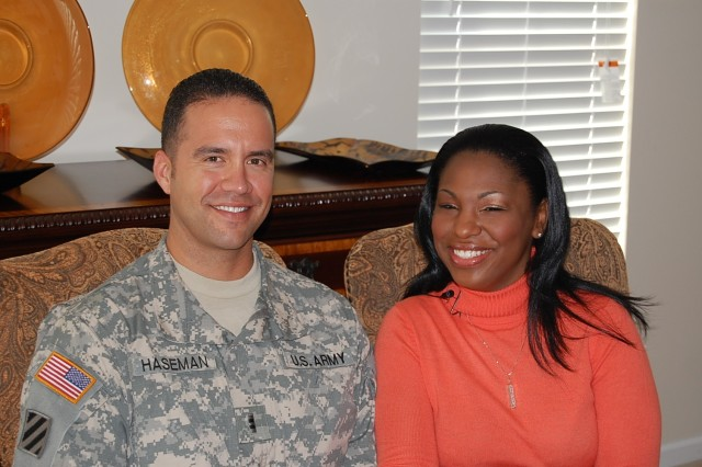 "Newlyweds Latrice and warrant officer Robert ""Dan"" Haseman, 260th Quartermaster Battalion pose for a picture after it was announced they won an all-expense paid honeymoon to Santa Ynez wine country in southern California, courtesy of Lifetime's Army Wives."