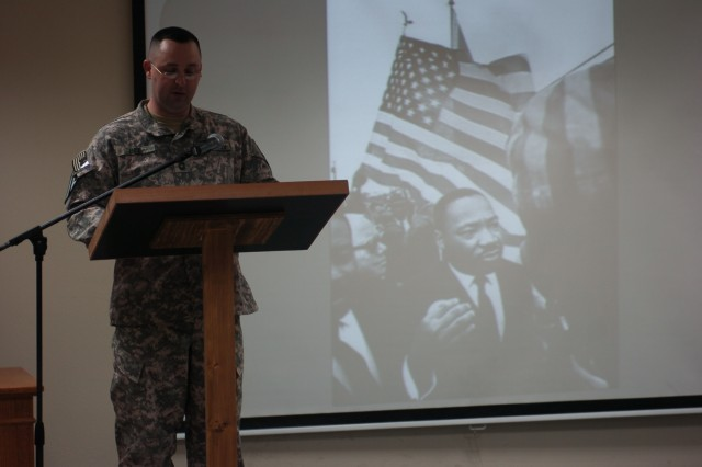 Staten Island, N.Y. native Sgt. Michelle Brown, the 2nd Brigade Combat Team, 1st Cavalry Division commander's assistant, reads part of a speech given by Dr. Martin Luther King Jr. She took part in the emotionally charged MLK day celebration that took place at the chapel on Jan. 20 at Camp Buehring, Kuwait.