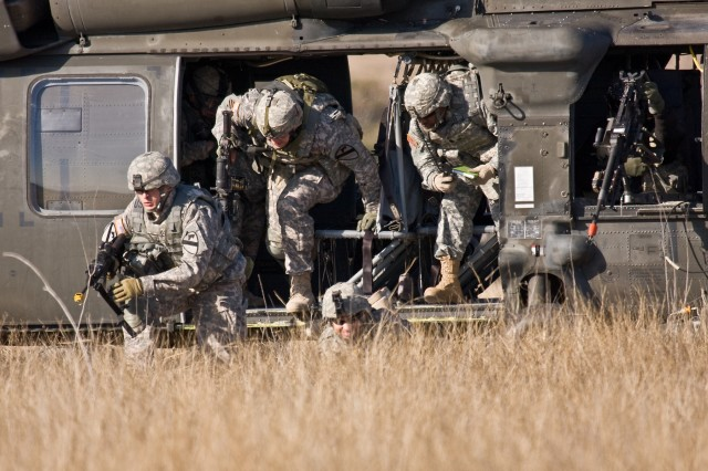 Soldiers from Company F, 3rd Assault Helicopter Battalion, 227th Aviation Regiment, 1st Air Cavalry Brigade, 1st Cavalry Division, hastily dismount a UH-60 Black Hawk helicopter to provide security for a downed aircraft during a training mission Jan. 15 at Fort Hood, Texas. The training exercise is to help integrate Soldiers of the Blues Platoon, who are mainly ground troopers, into an aviation unit.