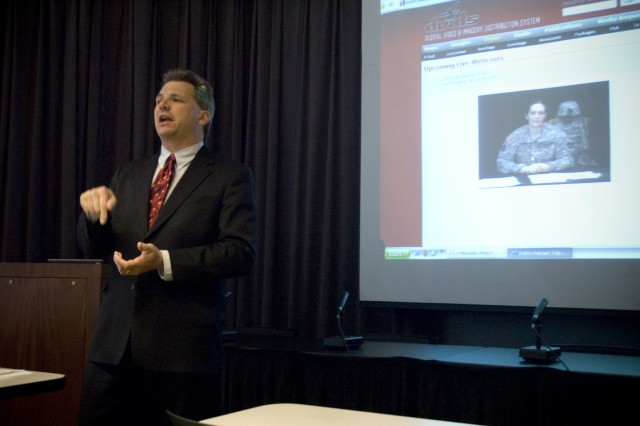 Brian Clauss, Executive Director, John Marshall Law School Veterans Legal Support Center & Clinic, introduces Capt. Lindsey Kimber, Staff Judge Advocate, 34 Task Force, Combat Aviation Brigade in Iraq, before a live web cast with law students and attorneys at a Veterans Advocacy Training seminar in Chicago, Ill. January 23, 2009.