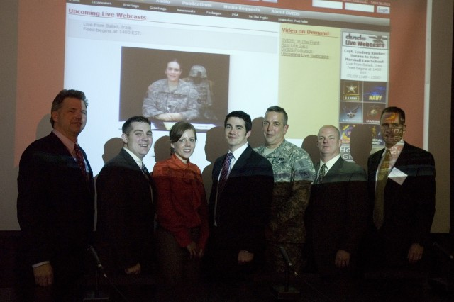 Capt. Lindsey Kimber, Staff Judge Advocate, 34 Task Force, Combat Aviation Brigade in Iraq, during a live web cast to law students and attorneys at a Veterans Advocacy Training seminar at the John Marshall Law school in Chicago, Ill. January 23, 2009. (L-R) Brian Clauss, Executive Director Veterans Legal Support Center & Clinic (VLSC), Nicholas Henry, Co-founder VLSC, Julie Yriart, Center Associate VLSC, Michael Barnicle, co-founder VLSC, Lt. Col. Scott Bleichwehl, Director Army Public Affairs Midwest, Joe Butler Director/Clinical Professor VLSC, John Anderson, Legal Assistance Foundation of Metropolitan Chicago's Veterans Rights Project.