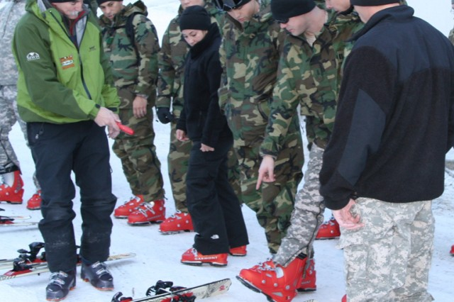Marc Jarvis, U.S. Army Garrison Ansbach Morale, Welfare and Recreation, assists Soldiers with ski selection during a test run of Installation Management Command-Europe's Warrior Adventure Quest program in Germany. The one-day event took about 30 Soldiers from the 12th Combat Aviation Brigade and a handful of garrison staff members to Garmisch for a day of Alpine skiing and snowshoeing.