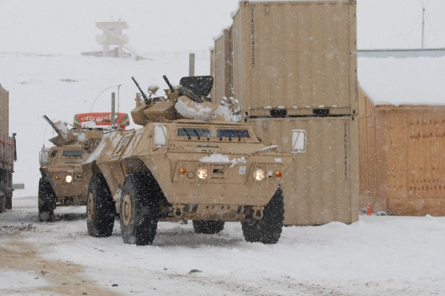 Armored vehicles move onto Forward Operating Base Shank, Afghanistan, as part of a convoy that carried soldiers to from the 10th Mountain DivisionAca,!a,,cs, 3rd Brigade Combat Team to the base from Bagram Airfield.