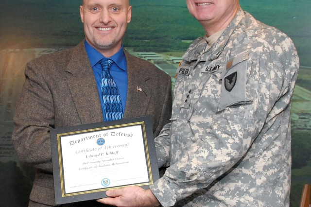 Edward Kilduff, left, graduated with honors from the Department of Defense's Security Specialist Course. Lt. Gen. James H. Pillsbury, deputy commanding general of the U.S. Army Materiel Command, presented the award during an award ceremony at Tobyhanna, Jan. 8.