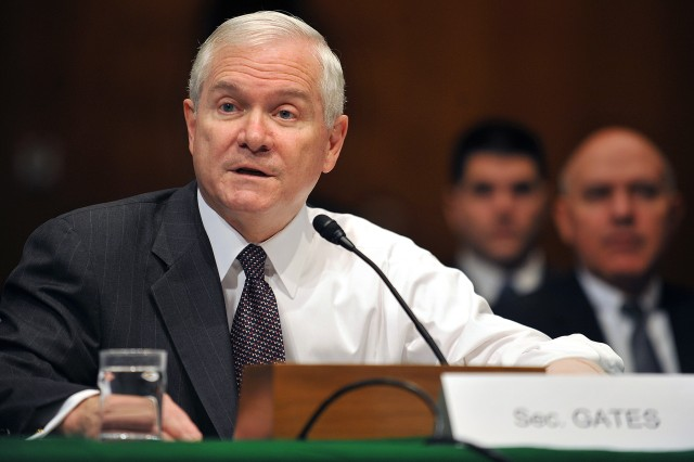 Defense Secretary Robert Gates testifies to the Senate Armed Services Committee Jan. 27 about an increase in National Guard domestic support missions and leveling down of reserve-component deployments. Gates wore his jacket halfway on due to surgery on his arm last week.
