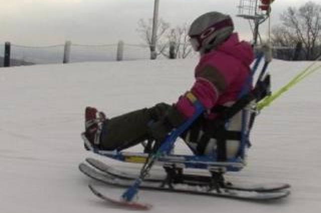 A voluteer learns to navigate the Whitetail Resort on a mono-ski designed for disabled athletes.