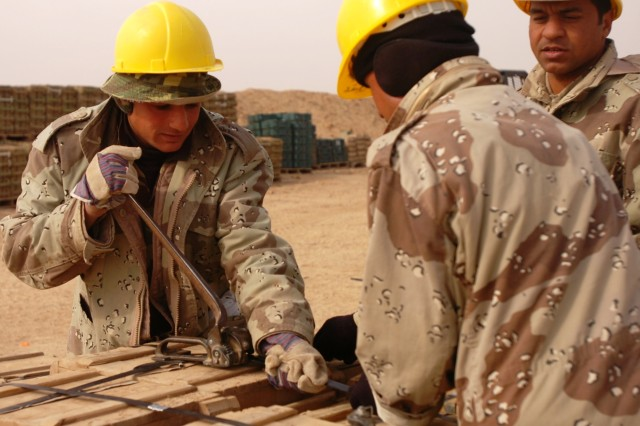 Iraqi Army Soldiers work to bind together ammunition pallets for storage at the Bayji National Ammunition Depot Jan. 26.