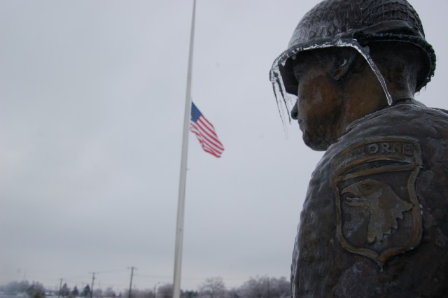 A statue of a Screaming Eagle Soldier stands frozen after an early morning ice storm at Fort Campbell, KY, Jan. 28, 2009.