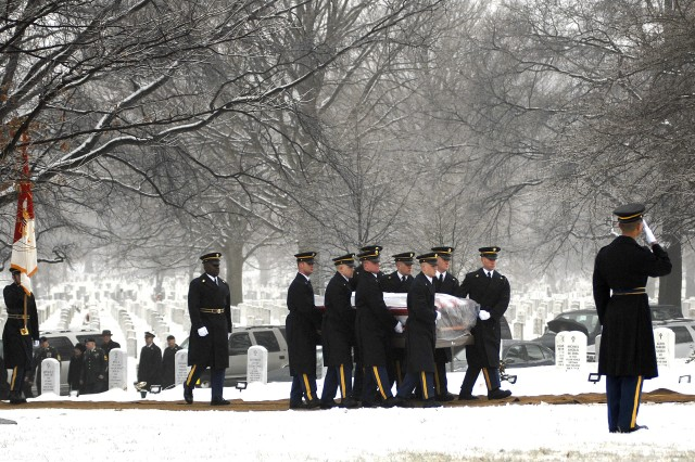 Soldiers of the 3rd U.S. Infantry (The Old Guard) carry former Sgt. Maj. of the Army William G. Bainbridge to his final resting place in Arlington National Cemetery.