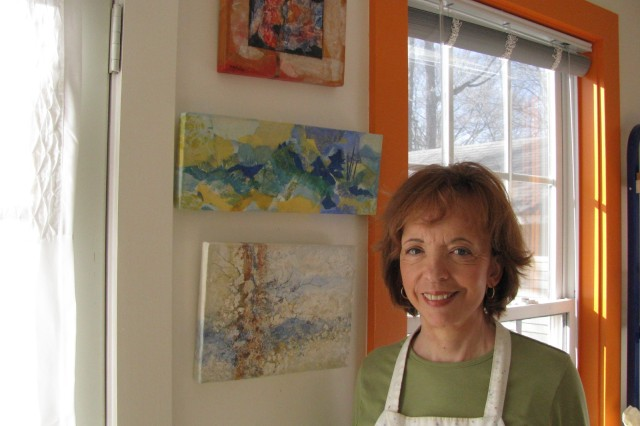 The walls of Judy Bobula's sunny art studio are adorned with her original collages, which continue to inspire her as she prepares for another season of outdoor art shows. Her work is on display at the Arts & Crafts Center as well as the Starbucks on Governors Drive.