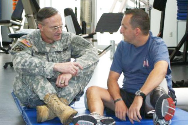 Army Staff Director, Lt. Gen. David Huntoon, talks with Army Cpl. John Hyland, C Company, Warrior in Transition Battalion, about injuries he sustained in Iraq. Huntoon toured Fort Sam Houston's Brooke Army Medical Center, the Center for the Intrepid, and the Institute of Surgical Research (Burn Unit), the Warrior and Family Support Center and the Soldier and Family Assistance Center, Jan 23.