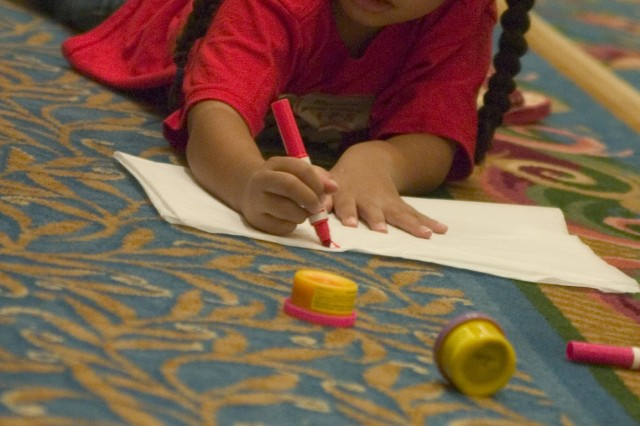 Monica Williams, 5, writes a letter to her father lost during the war in Iraq at the Tragedy Assistance Program for Survivors (TAPS) program, Jan. 24, at the Hilton Hawaiian Village. The program helps families of U.S. military service members who have died in service to the United States.