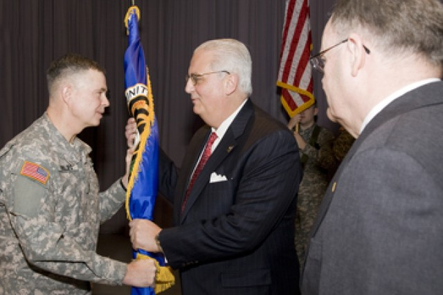 PICATINNY ARSENAL, N.J. -- Brig. Gen. William N. Phillips (left) hands the PEO Ammunition flag to Dean G. Popps as James Sutton watches.