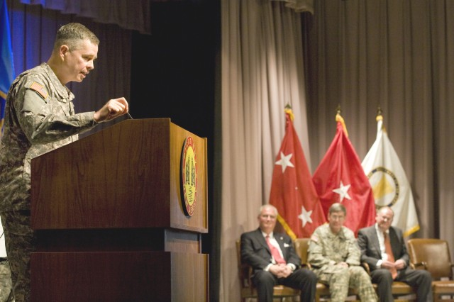 PICATINNY ARSENAL, N.J. -- Picatinny Commanding General Brig. Gen. William N. Phillips speaks to a Picatinny audience during a change-of-charter ceremony here Jan. 23. Shown in the background are (from left) Dean G. Popps, principal deputy assistant secretary of the Army for Acquisition, Logistics and Technology, Lt. Gen. N. Ross Thompson III, military deputy to the assistant secretary of the Army for Acquisition, Logistics and Technology, and James C. Sutton, new program executive officer for Ammunition.