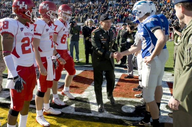 Gen. David Petraeus shakes the hands of the football players from the University of Houston and the U.S. Air Force Academy at the sixth annual Bell Helicopter Armed Forces Bowl prior to the coin toss Dec. 31, 2008. Petraeus will also officiate over the ceremonial coin toss in Super Bowl XLIII.