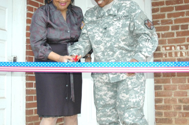 "Col. Deborah Grays (right), U.S. Army Garrison commander, Fort McPherson and Fort Gillem, Ga., and Marcia Parker, chief of the Legal Assistance Section of the garrison Office of Staff Judge Advocate, Fort McPherson, Ga., officially open the Fort McPherson Tax Center Jan. 26, 2009 in a ribbon-cutting ceremony held at Bldg. 52. ""This is one of the most phenomenal programs on post,"" Grays said, adding that with the current financial crisis, the money saved by those using the free services at the center will help even more. The Tax Center is open to active duty military, activated Reserve and National Guard Soldiers and retirees.  Last year, the center saved the military community $432,362 in filing fees."