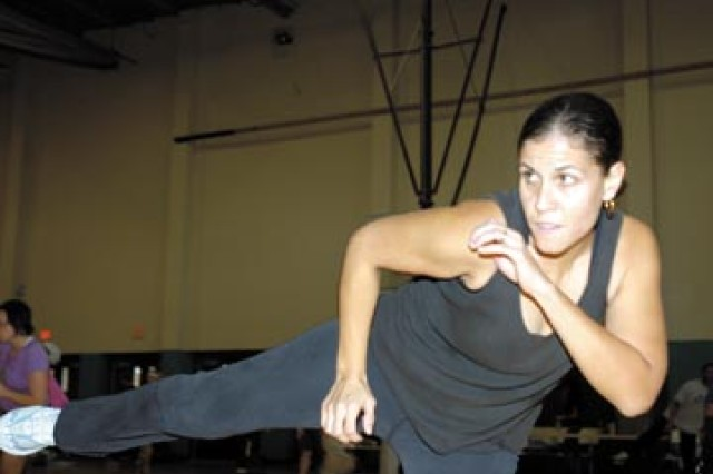 Margerie Lopez does a side kick while participating in a kick-boxing class during the 2009 Aerobathon; a showcase of different kinds of fitness programs offered at Newman Fitness Center.