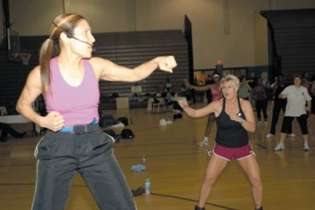 Carmen Cooper instructs kick boxing, one of a variety of exercises offered to Soldiers and Family Members, Jan. 24 at Newman's 12th annual Aerobathon.