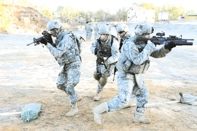 Soldiers from Co. B, 1/15th Inf., 3rd HBCT, practice room-clearing techniques, Jan. 15 at a firing range on Fort Benning, Ga. Soldiers in Co. B spent two days at the range getting their timing right during, reflexive firing and close-quarters combat training.