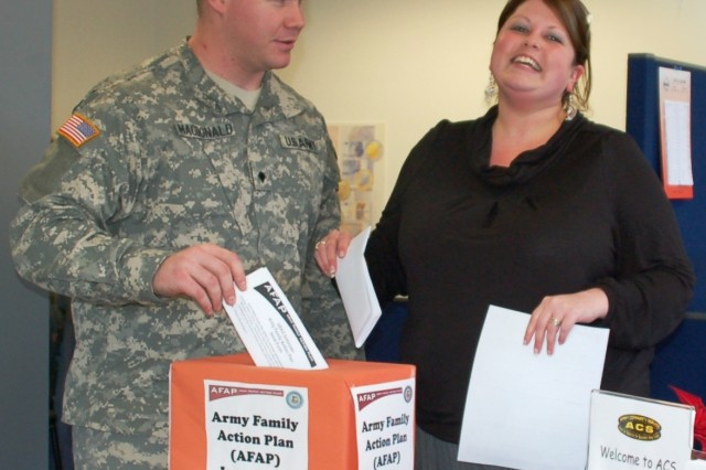 Army Spc. Bruce W. MacDonald, of the HHC AFNORTH Battalion, and Marne Kosobucki, AFNORTH Family Readiness Support Assistant, submit issues via drop boxes located around the Tri-Border region. All issues submitted will be addressed during the Army Family Action Plan Conference, Feb. 17 & 18, at the JFC Conference Center, Brunssum, Netherlands. (Photo: Tom Budzyna, USAG Schinnen Public Affairs)