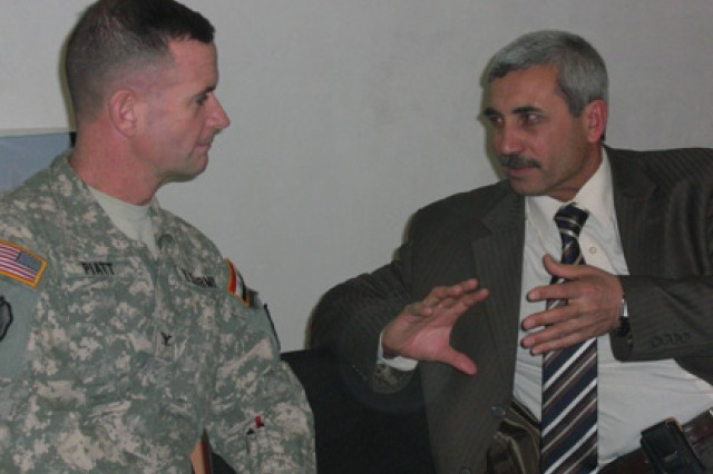 Col. Walter Piatt, commander, 3rd Brigade Combat Team, 25th Infantry Division, speaks with Abdullah Hussein Jabouri, the deputy governor of Salah ad-Din Province at an elections security meeting chaired by Abdullah in Tikrit, Iraq Jan. 27.  Representatives from the Iraqi High Electoral Commission, the Iraqi Police, Iraqi Army, the U.S. Army, the U.S. State Department and the mayors from the major towns and cities in the province attended the meeting to make final security coordinations for the upcoming Jan. 31 provincial elections. (U.S. Army Photo by Maj. Cathy Wilkinson, 3rd Brigade Combat Team, 25th Infantry Division Public Affairs).