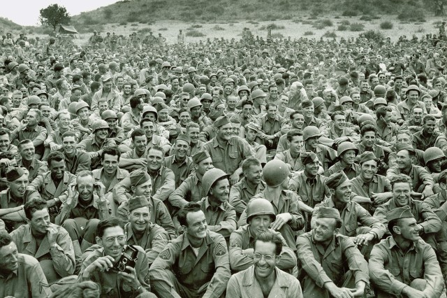 During World War II, soldiers enjoy an Al Jolson Show (Henry Utley Milne Photograph Collection).