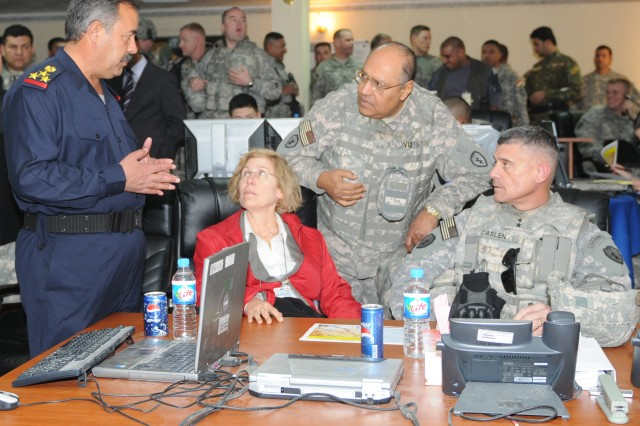 Staff Brig. Gen. Issa Abed Mahud, the Salah ad-Din Provincial Joint Coordination Center director briefs the progress of elections to Joanne Cummings, U.S. State Department foreign policy advisor and Maj. Gen. Robert L. Caslen, Jr. Multi-National Division-North commanding general here Jan. 31.  The PJCC coordinated the security and elections operations for the province. (U.S. Army Photo by Maj. Cathy Wilkinson, 3rd Brigade Combat Team, 25th Infantry Division.)