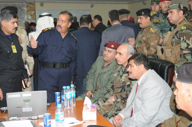 Staff Brig. Gen. Issa Abed Mahud, the Salah ad-Din Provincial Joint Coordination Center director briefs the progress of elections to Staff Maj. Gen. Salah eh Din Mustafa, the 4th Iraqi Army Division commander, Gen. Babakir Zebari, the Chief of Staff of the Iraqi Army and Salah ad-Din Gov. Hamid Hamud here Jan. 31. The PJCC coordinated the security and elections operations for the province. (U.S. Army Photo by Maj. Cathy Wilkinson, 3rd Brigade Combat Team, 25th Infantry Division.)