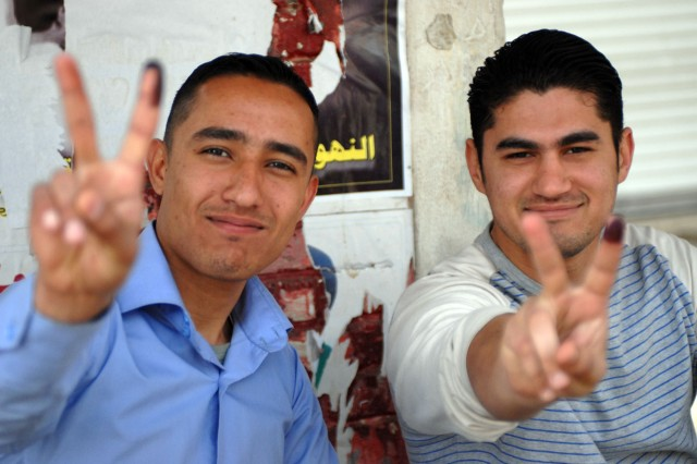 Two men show off their newly inked fingers after voting in the Iraqi provincial elections in the Adhamiyah District of Baghdad Jan. 31.