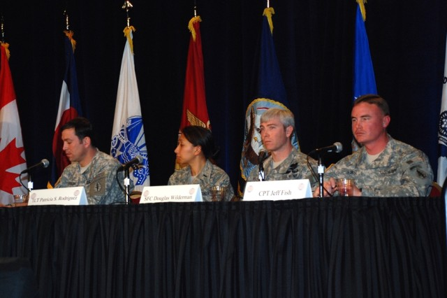 From left to right, Maj. Ty Hensley, Group Support Company Commander, 10th Special Forces Group (Airborne); 1st Lt. Patricia Rodriguez (USAF), Deputy Flight Commander, Plans and Resources Flight, 60th Communications Squadron; Sgt. 1st Class Douglas Wilderman, GSC Signal Detachment Sergeant, 10th Special Forces Group (Airborne); and Capt. Jeff Fish, Rear Detachment S6, 10th Special Forces Group (Airborne), sat on the warfighter panel at the 11th Annual SPACECOMM Defending America Symposium, conducted Jan. 28 at the Broadmoor Hotel. The panel was chaired by Brig. Gen. Kurt S. Story (not pictured), Deputy Commanding General for Operations, U.S. Army Space and Missile Defense Command/Army Forces Strategic Command.
